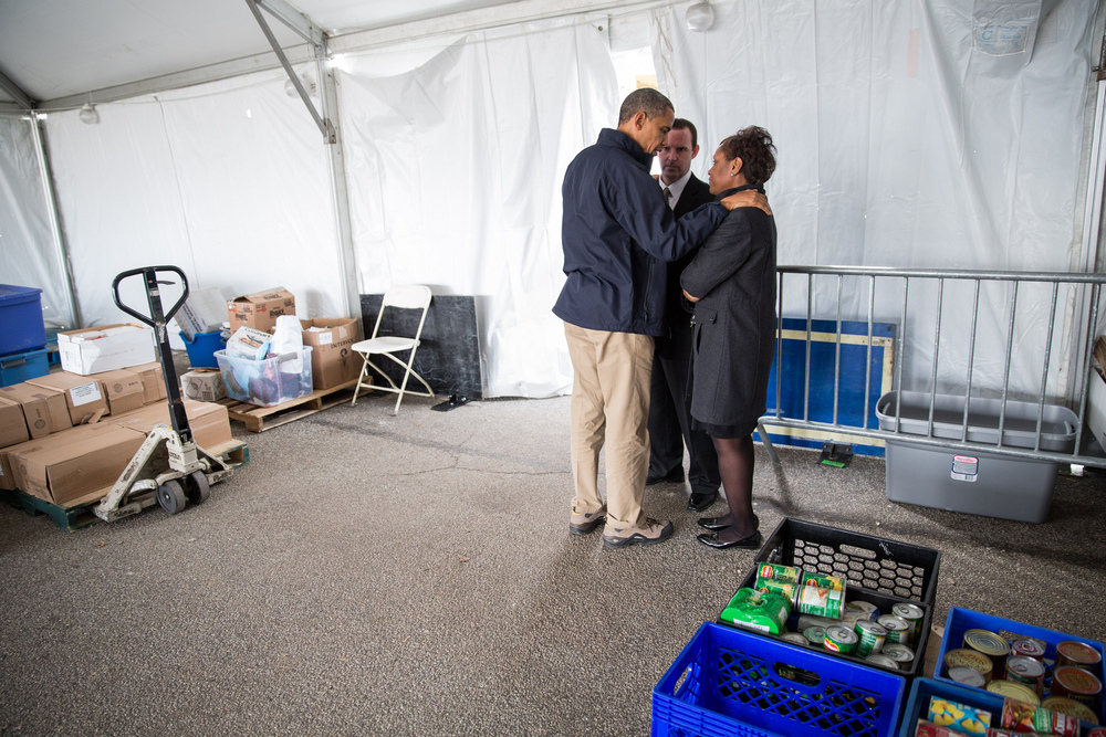 """Nov. 15, 2012   """"The President tries to comfort Damien and Glenda Moore at a FEMA Disaster Recovery Center tent in Staten Island, N.Y. The Moore's two small children, Brandon and Connor, died after being swept away during Hurricane Sandy."""" (Official White House Photo by Pete Souza)"""