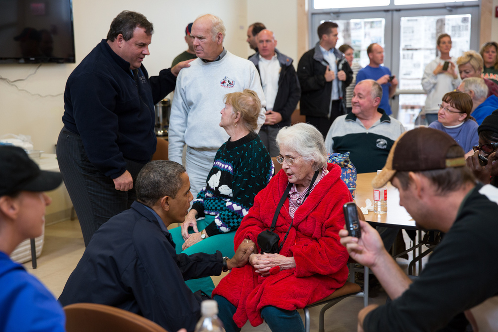 """Oct 31, 2012   """"The President and New Jersey Gov. Chris Christie talk with local residents affected by Hurricane Sandy at the Brigantine Beach Community Center in Brigantine, N.J."""" (Official White House Photo by Pete Souza)"""