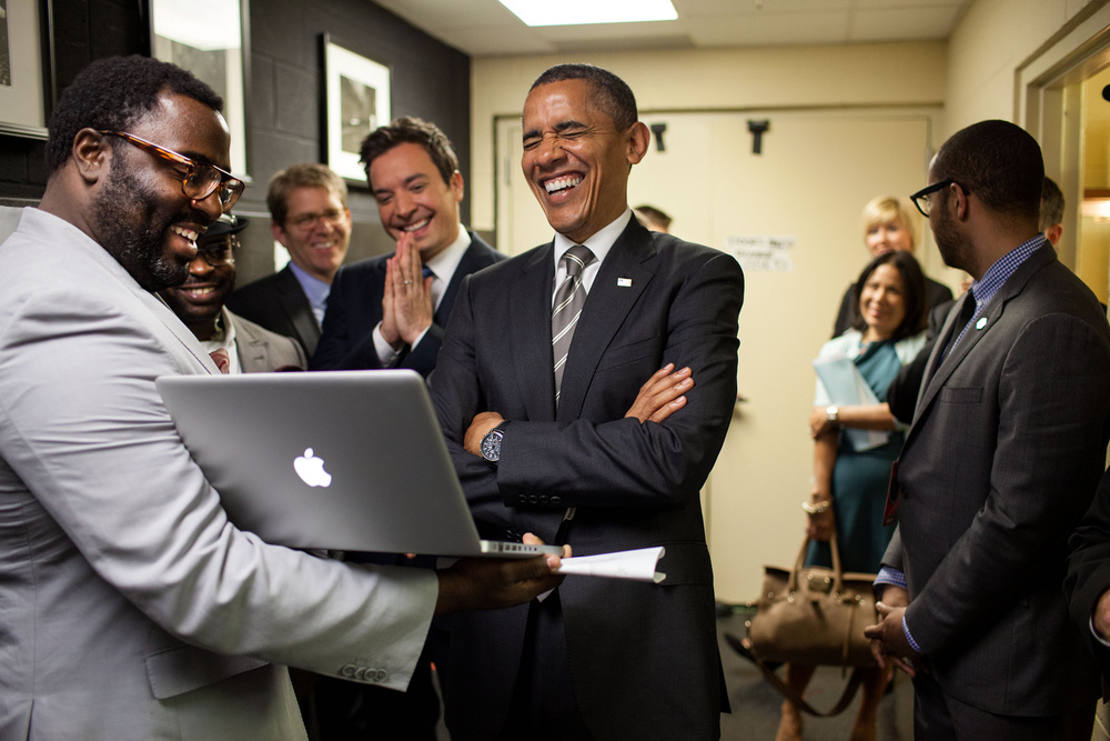 """April 24, 2012 """"We were backstage at the University of North Carolina in Chapel Hill for the President's appearance on 'Late Night with Jimmy Fallon.' The President let out a big laugh as he was being briefed by the producers and Mr. Fallon on the 'Slow Jam the News' segment."""" (Official White House Photo by Pete Souza)"""