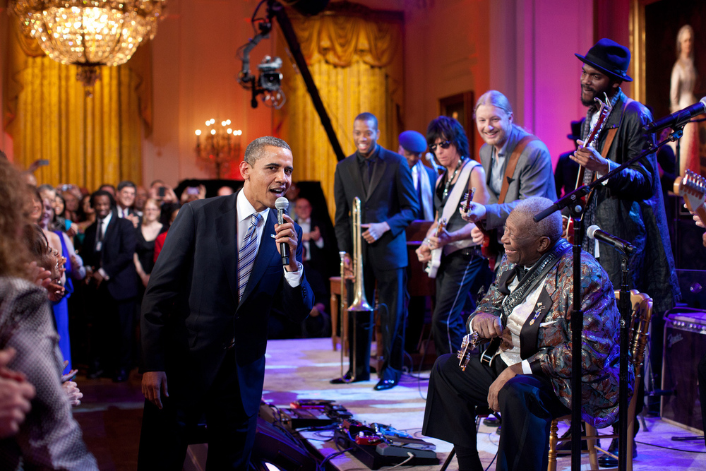 """Feb. 21, 2012  """"Egged on by B.B. King, at right, the President joins in singing 'Sweet Home Chicago' during the 'In Performance at the White House: Red, White and Blues' concert in the East Room. Participants include, from left: Troy 'Trombone Shorty' Andrews, Jeff Beck, Derek Trucks, B.B. King, and Gary Clark, Jr."""" (Official White House Photo by Pete Souza)"""