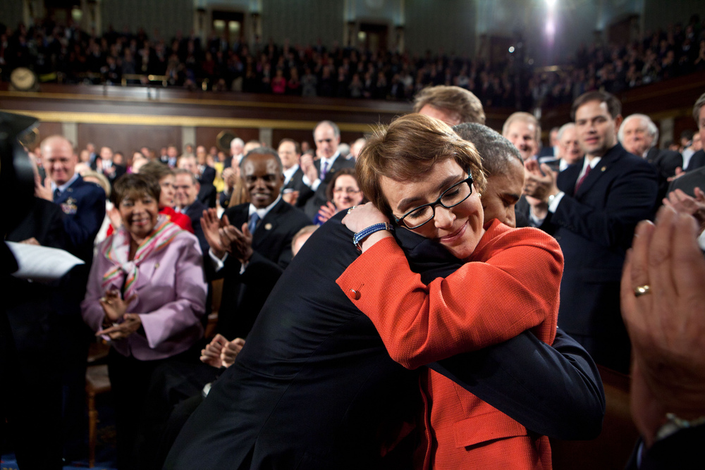 """Jan. 24, 2012  """"One of the most memorable moments of the year was when the President hugged Rep. Gabrielle Giffords as he walked onto the floor of the House Chamber at the U.S. Capitol to deliver his annual State of the Union address."""" (Official White House Photo by Pete Souza)"""