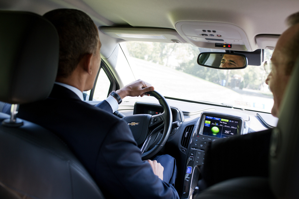 """Oct. 12, 2012 """"The President had invited former White House Press Secretary Robert Gibbs to have lunch, and they apparently started talking about Gibb's Chevy Volt. Gibbs knew the President had visited one of their factories and was hoping to drive a Volt one day. Gibbs told the President that his car was on the South Drive. So the President jumped in and made three loops around the drive, joking later that the Secret Service ordered that the White House gates not be opened under any circumstances."""" (Official White House Photo by Pete Souza)"""