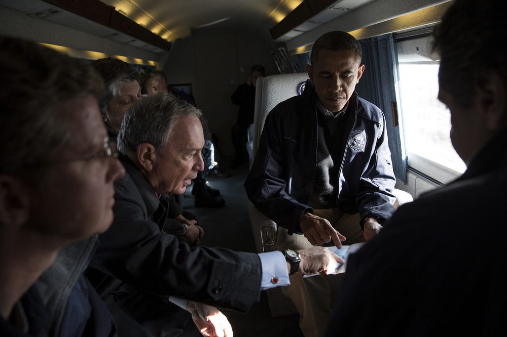"""Nov. 15, 2012  """"New York City Mayor Michael Bloomberg views a map with the President during an aerial tour to view damage from Hurricane Sandy in Breezy Point, the Rockaways and Staten Island in NYC. Also onboard were New York Gov. Andrew Cuomo, Shaun Donovan, Secretary of Housing and Urban Development, and Janet Napolitano, Homeland Security Secretary."""" (Official White House Photo by Pete Souza)"""