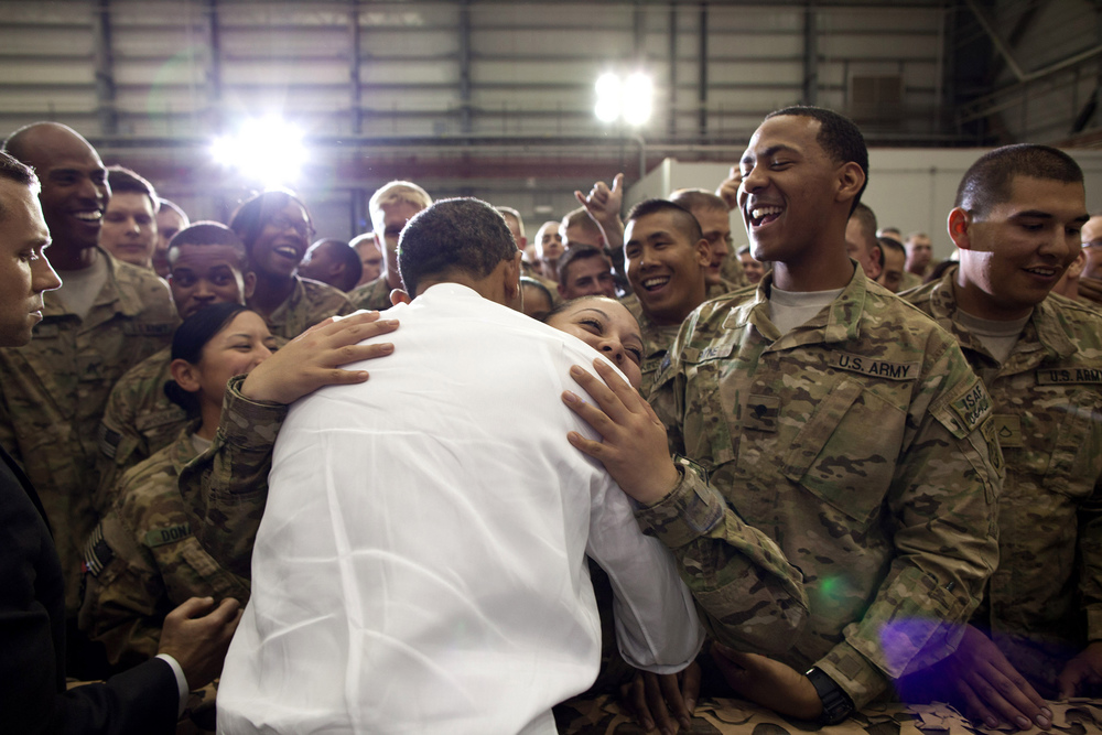 """M ay 1, 2012 """"A soldier hugs the President as he greeted U.S. troops at Bagram Air Field in Afghanistan."""" (Official White House Photo by Pete Souza)"""
