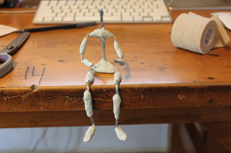 Wire stop motion armature