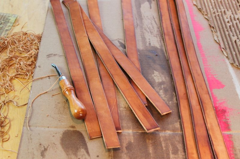 Cutting and oiling straps for waxed canvas bags
