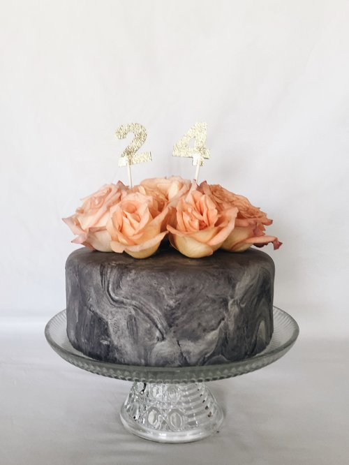 Spice cake with cinnamon buttercream and marbled marshmallow fondant.