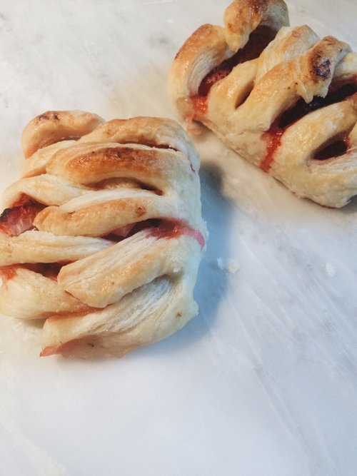 Braided croissants stuffed with strawberries and pastry cream.