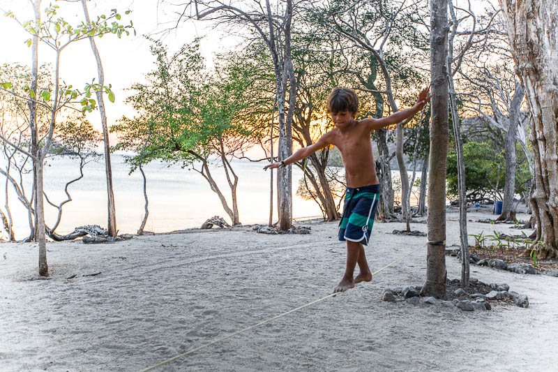 Child practices the art of tight rope walking at a performance event in Playa Dante, Costa Rica.