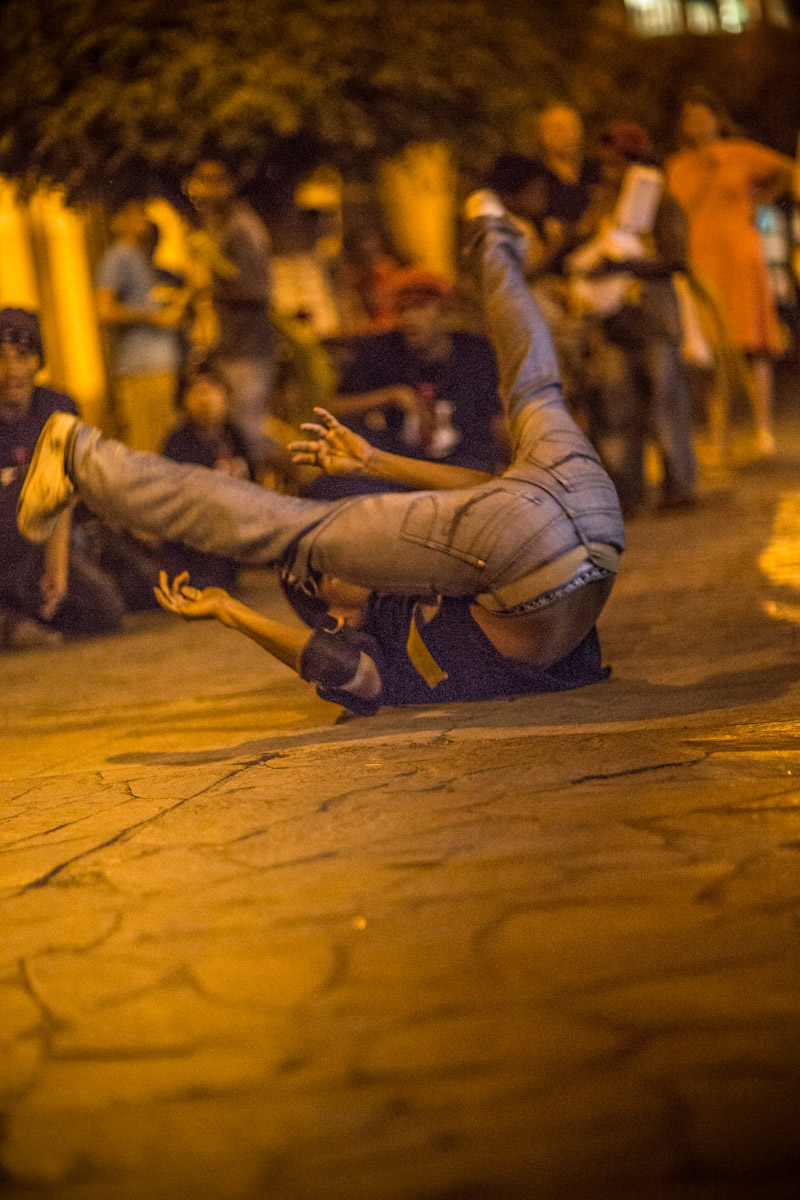 Granada Nicaragua. Street dancer performing some classic break dancing moves.