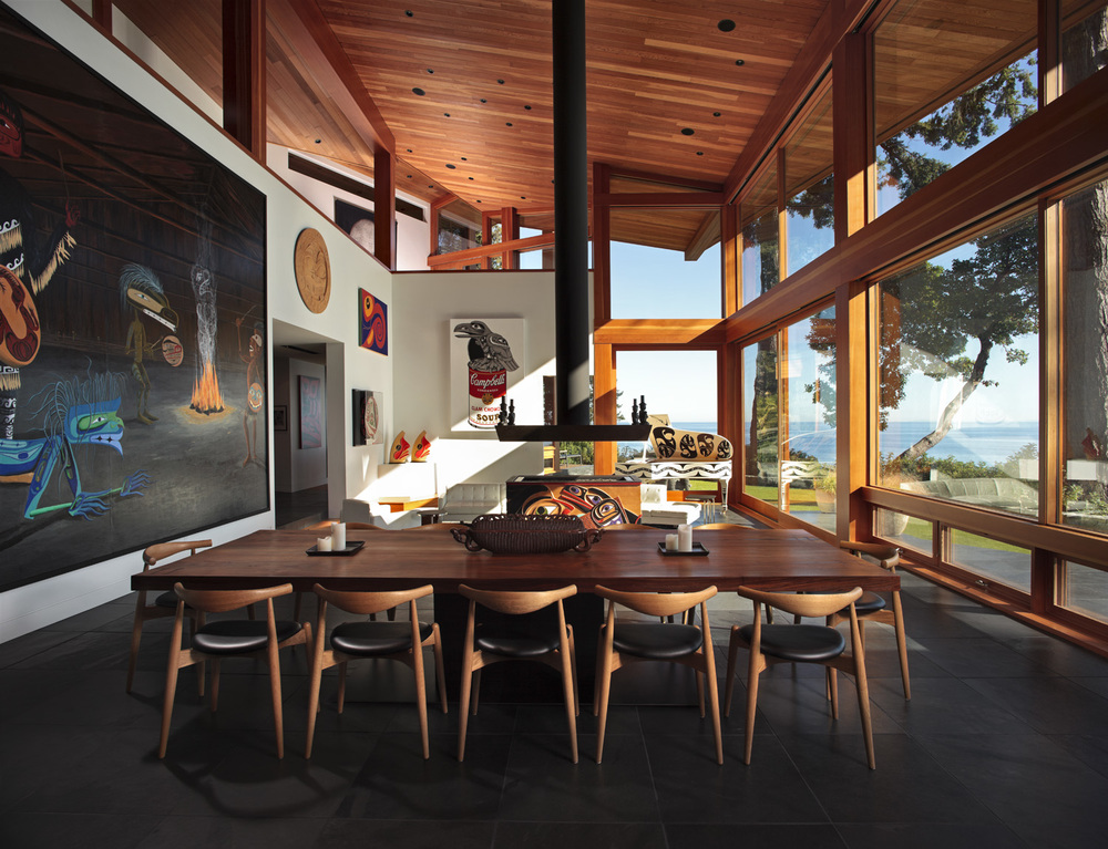 The interiors are designed to connect the interior to the exterior. Large columns support large expanses of roof to mimic the trees and their horizontal canopies, slate walls carry through the house from interior to exterior and back out again, and water flows from a man made creek up and around the house.