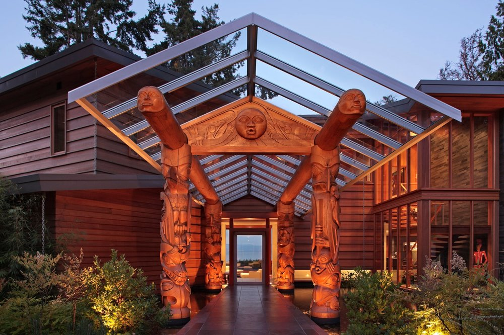 "Motivated by the clients love and appreciation for contemporary and traditional art (First Nations and Contemporary Canadian Art) the house, a conceptual Longhouse, has been re-configured to the site and needs of the clients with totems celebrating the point of entry in compression, fireplaces commanding the ""spiritual center"" of the house and free flowing open plan to promote community."