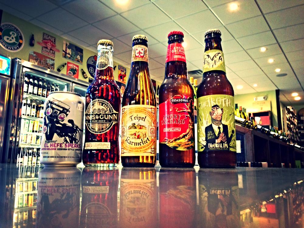 DC Brau's El Hefe Speaks Hefeweizen, Innis & Gunn Rum Cask, Triple Karmeliet, Angry Orchard Cinnful Cider, and Flying Dog The Truth Imperial IPA