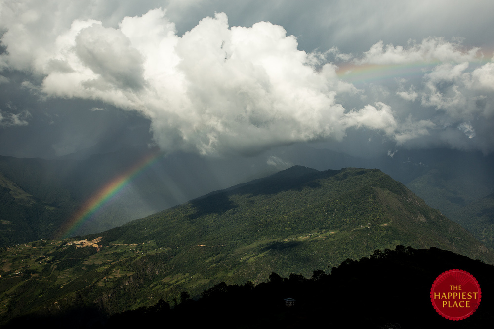 A rainbow emerges in the hills of Lhuentse, Bhutan on one of the final days of our return trip.