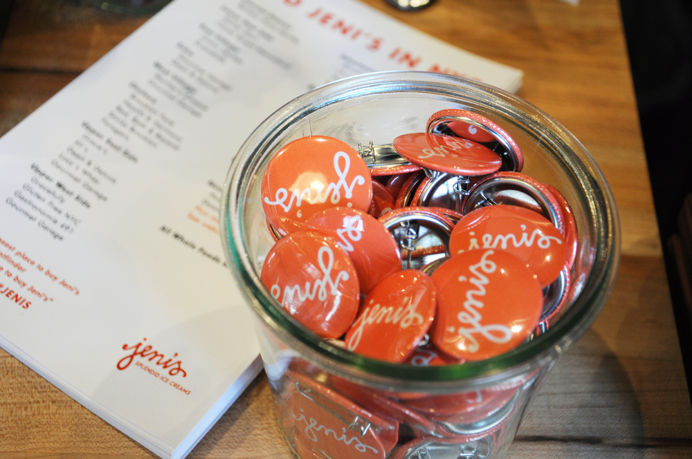 Jeni's signature bright orange pins at the counter