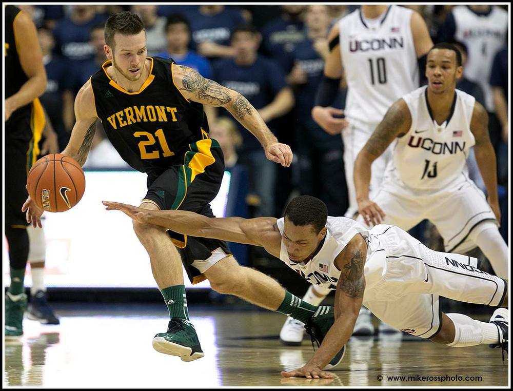 UCONN'S #21 Omar Calhoun fights for a loose ball against Vermont's # 21 Candon Rusin during second half action on Tuesday November, 13 2012. UCONN would win 67-49.