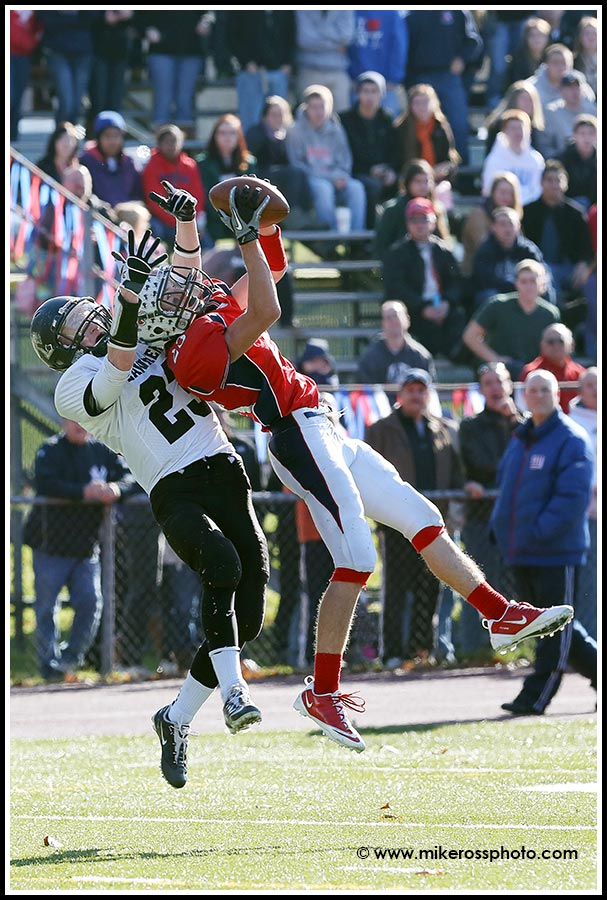 Mike Ross Connecticut freelance -Foran High School's # 23 Connor Cadrin battles and intercepts the pass from Jonathan Law's #23 Timmy Speer during first action on Thanksgiving football match-up. Foran would win 56-29.