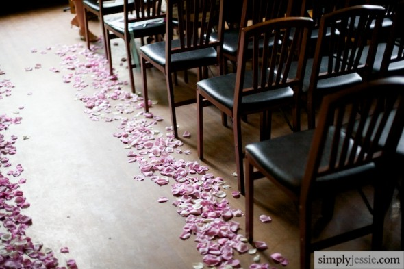 Rose petals down aisle