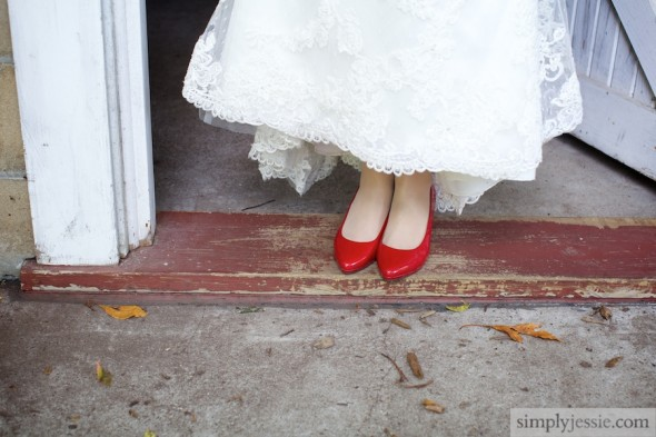 Red shoes on bride