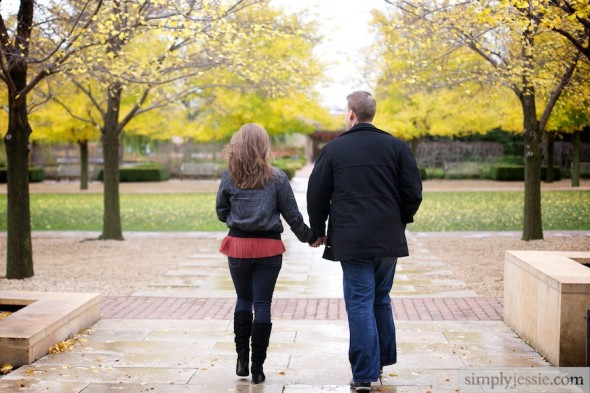 Engaged couple walking in Fall color