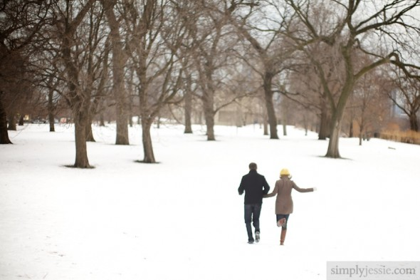 Engaged Couple running through snow