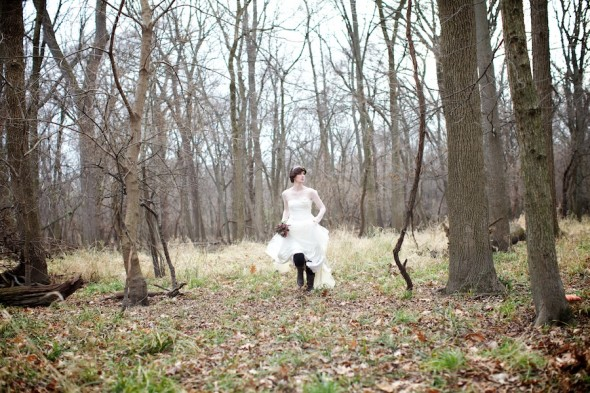 Bride running through woods