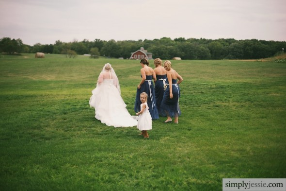Bridesmaids & bride walking across field