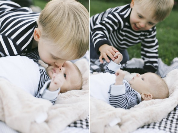 Big brother kissing new baby boy photography