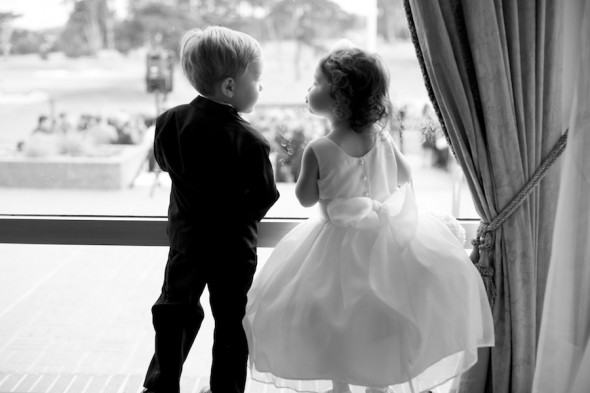 Ringbearer and Flowergirl about to kiss