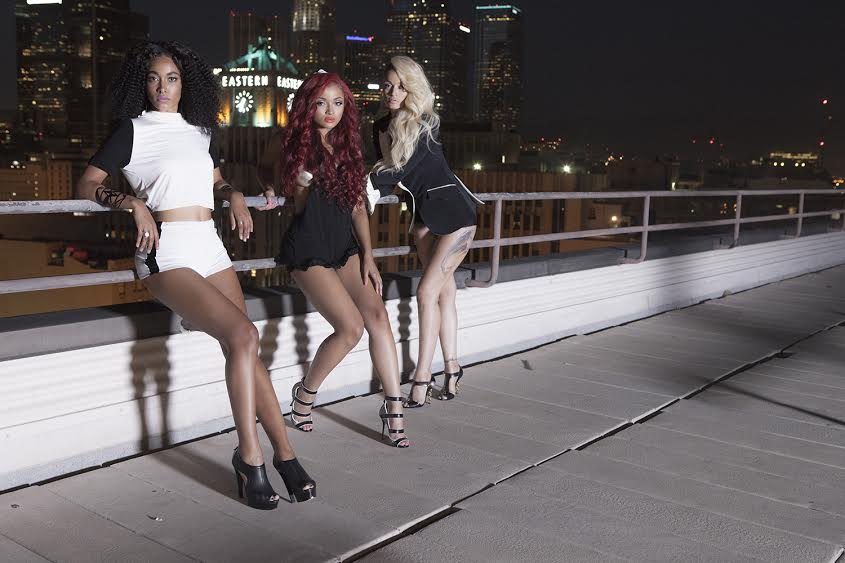 Charli and Daughters on Roof Glam Pose.jpg