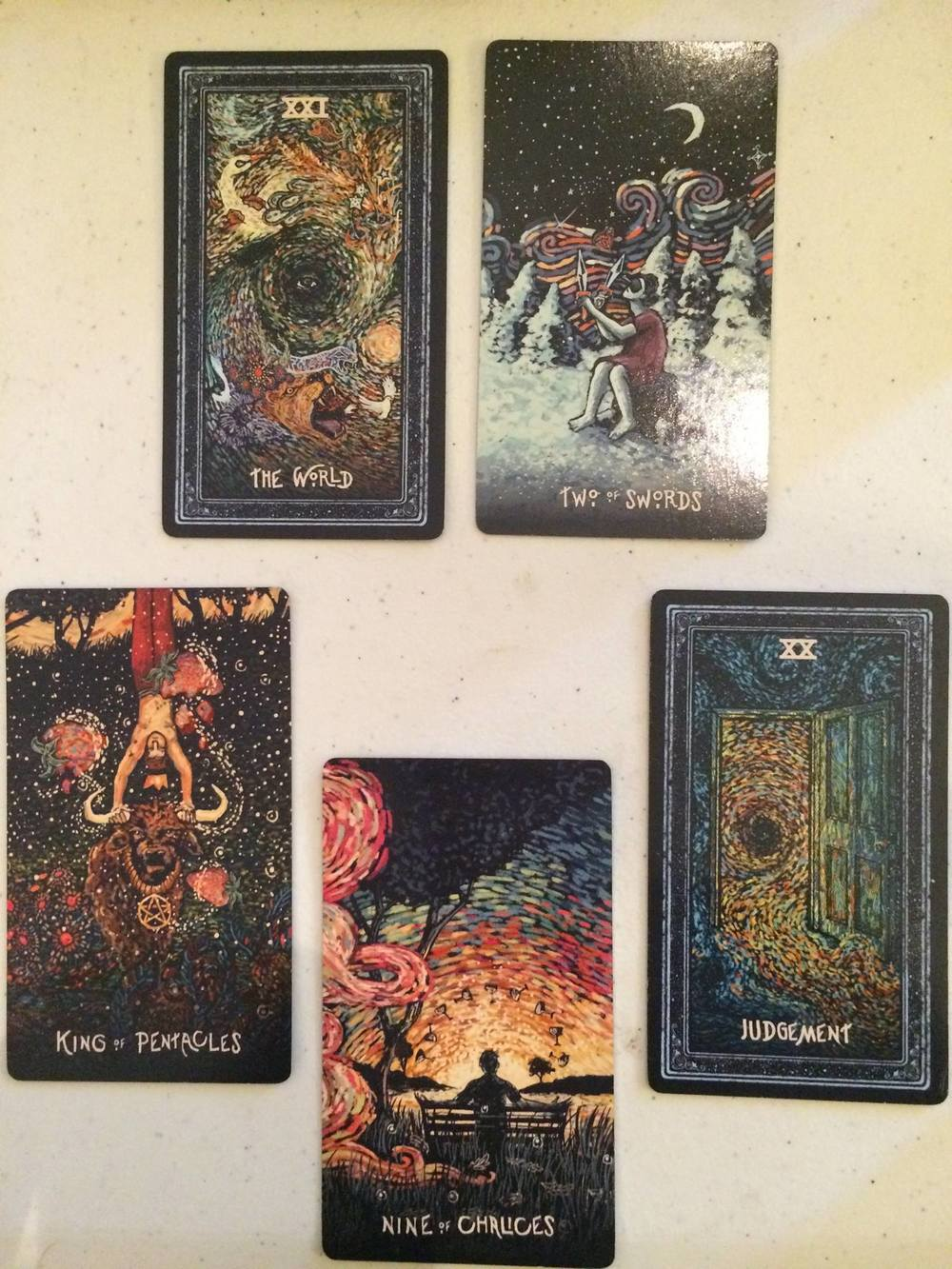 (9 of Cups, King of Pentacles, XXI The World, 2 of Swords, XX Judgement; Prisma Visions Tarot)