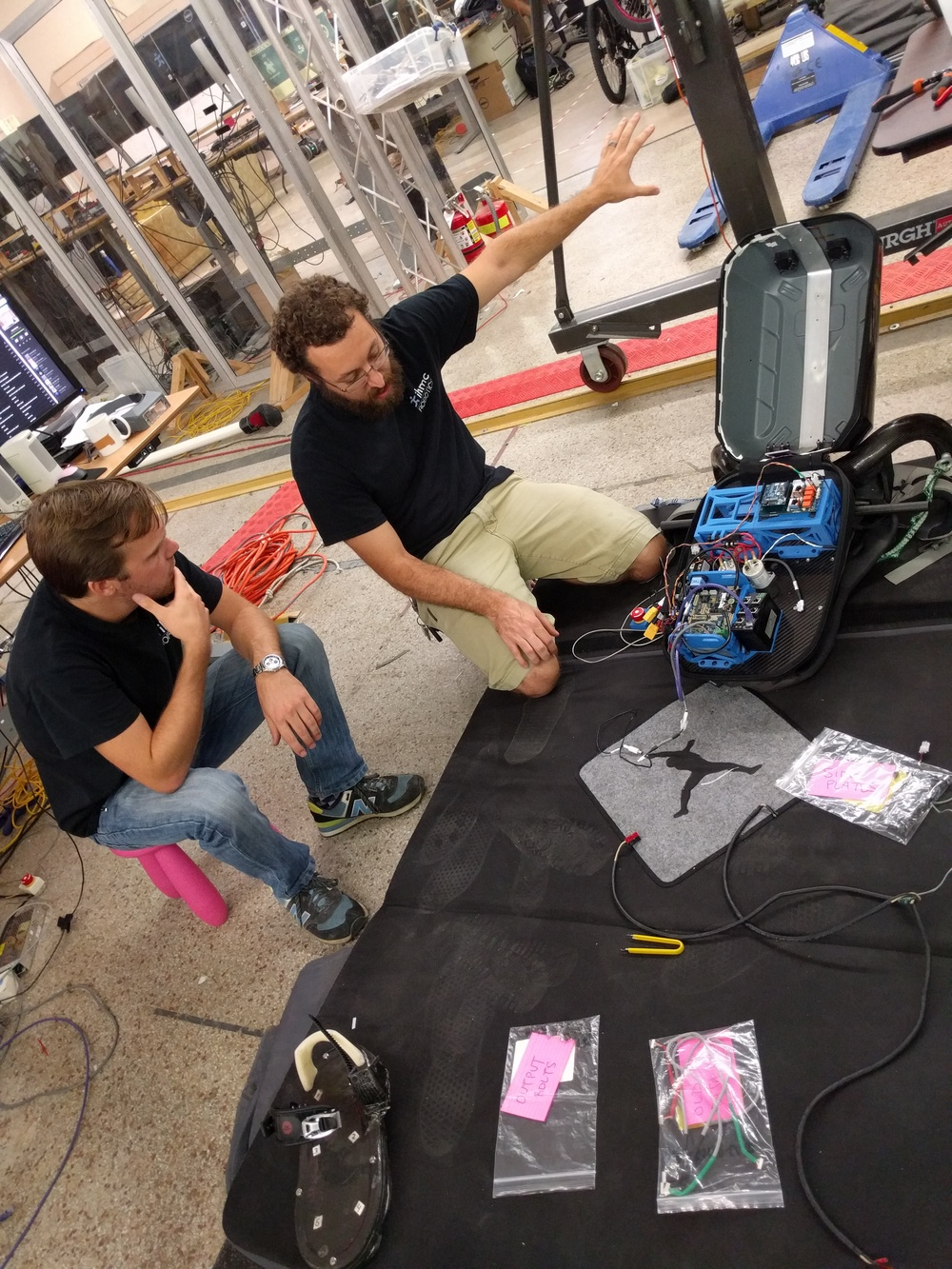 Olger (left) and Travis (right) reviewing the electronics in the backpack.