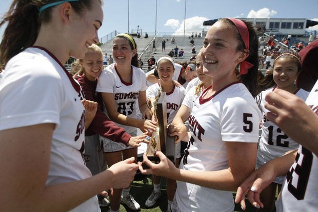 Summit's #5 Meaghan Celmer hold the trophy. NJSIAA Girls Lacrosse State Championships 2014, group 2 Summit vs. Red Bank Catholic at Monmouth University in West Long Branch. Summit wins 15-3. Saturday May, 31, 2014 (Patti Sapone/The Star-Ledger)