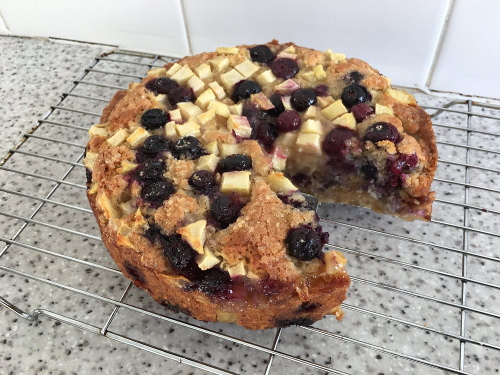 Pear, blueberry, and coconut cake