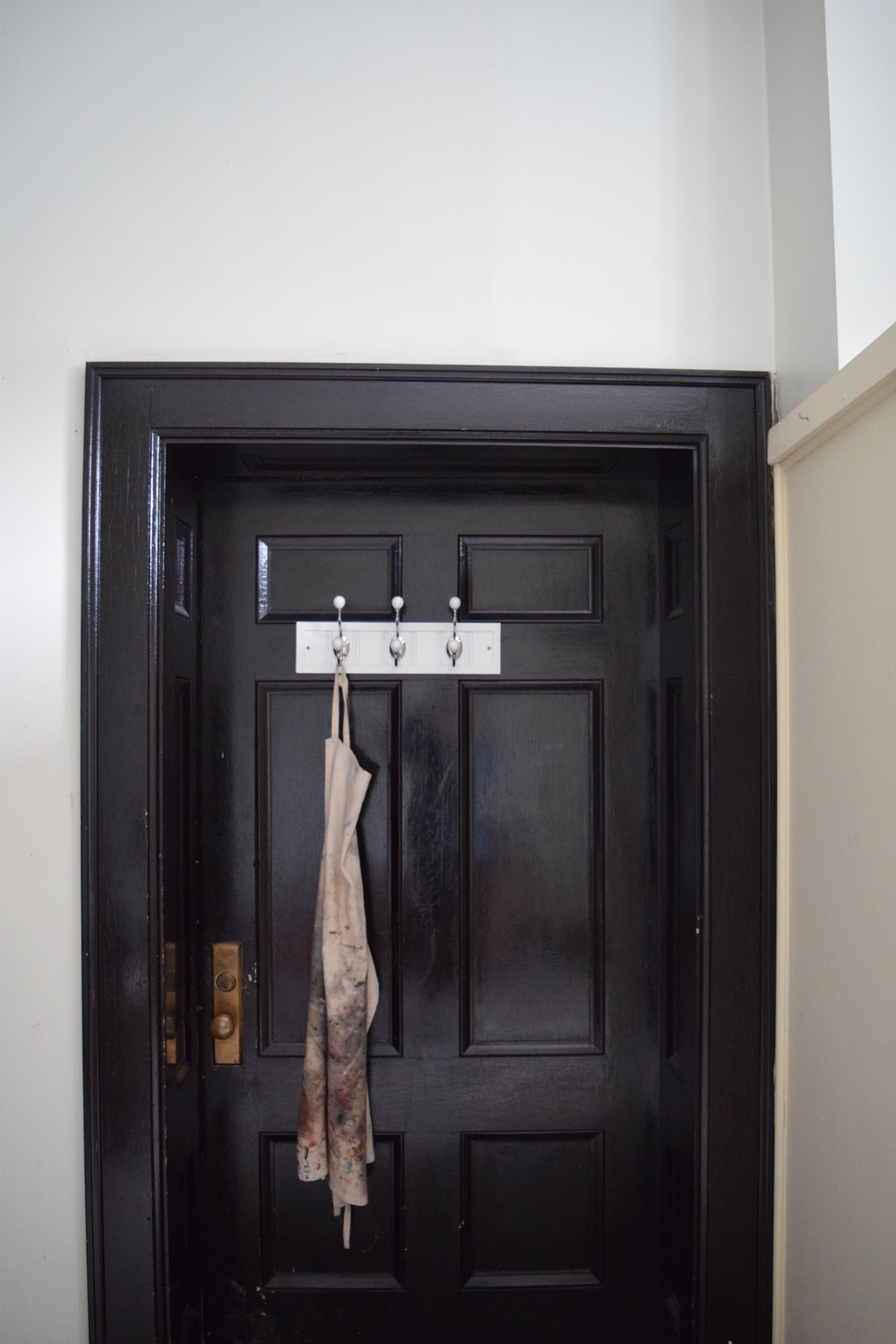 The door to my loft studio on Germain Street. I claimed it with my paint apron.