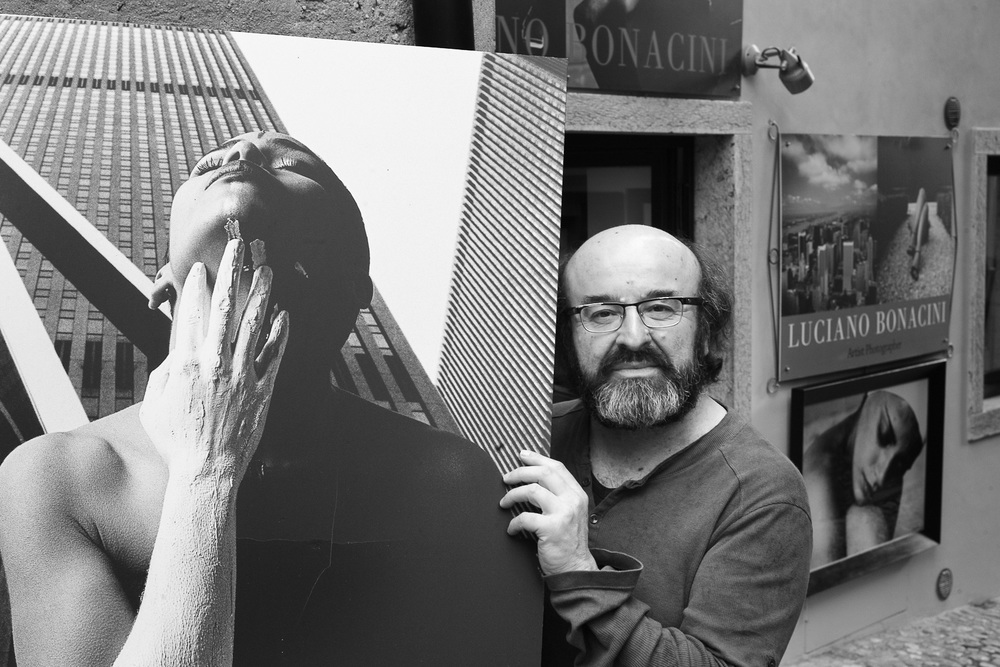 Luciano Bonacini in front of his gallery in Malcesine, Italy