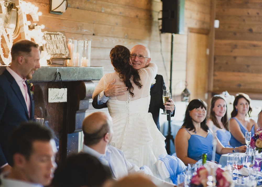 The father of the bride told some cute stories for his toast.