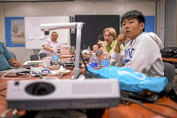 Isaac Kim, right, and other   members of North Hollywood High's CyberPatriot team prepare for their trip to Washington, D.C., to compete in the CyberPatriot VI Games. (Photo by David Crane/Los Angeles Daily News)