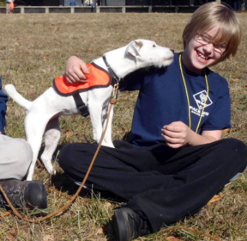K9 Scout loving on Cub Scout