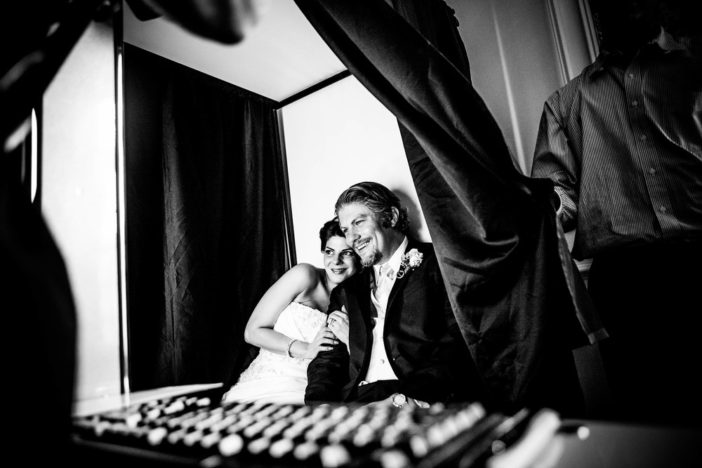 bride and groom in photobooth photograph by westchester wedding photographer