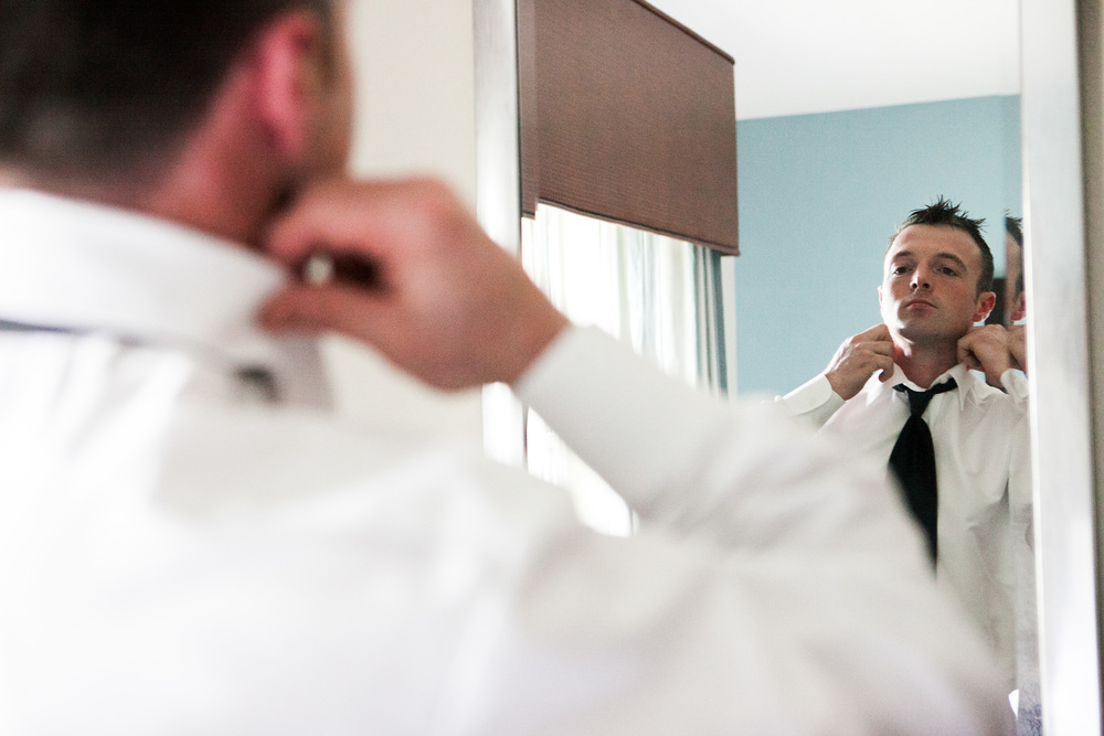 groom getting ready photo by westchester wedding photographer