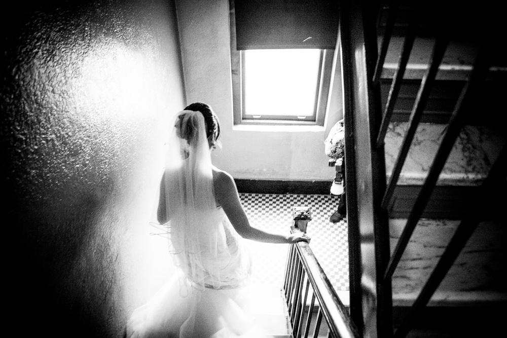 bride going downstairsby westchester wedding photographer