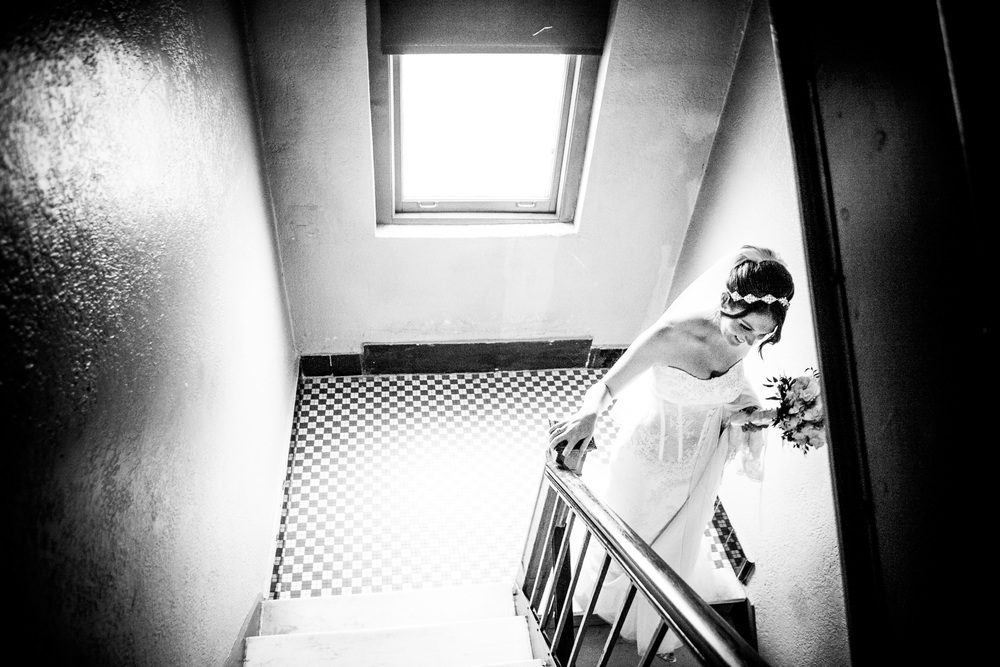 bride going down stairs by by westchester wedding photographer