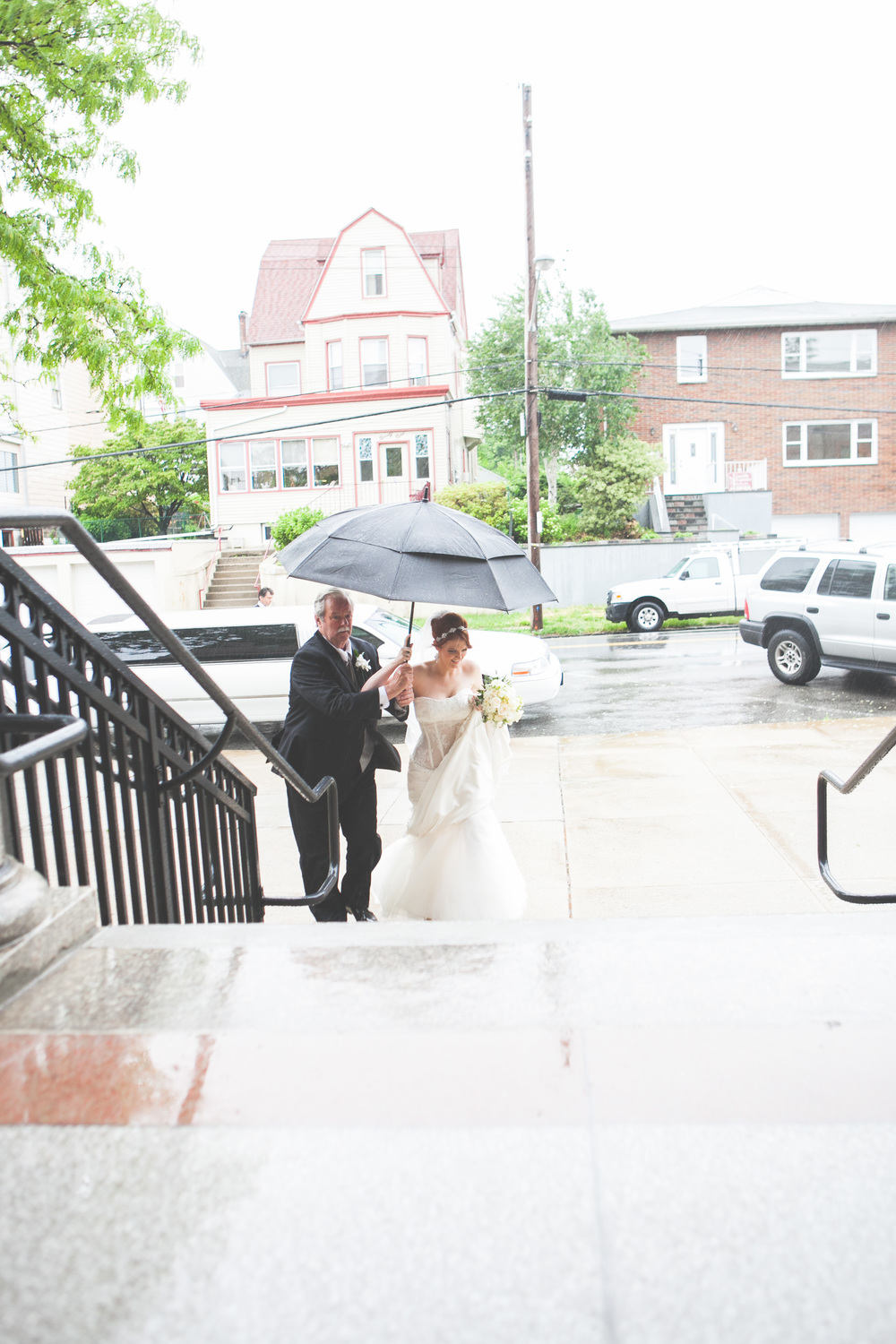 bride walking to christ the king church by westchester wedding photographer