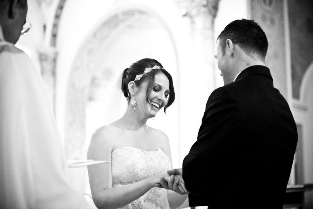 exchanging rings atchrist the king church by westchester wedding photographer