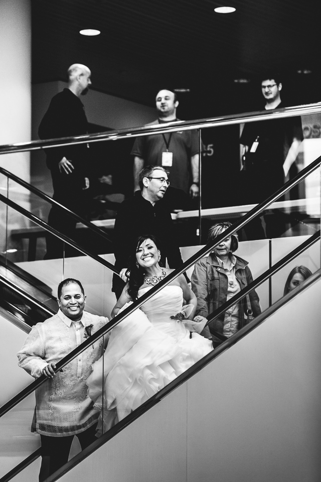 bride and groom on escalator in rock and roll hall of fame