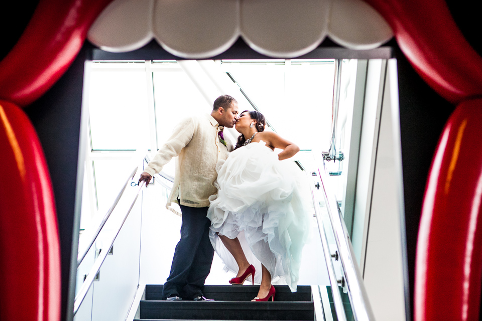 bride and groom fun photo at rock and roll hall of fame