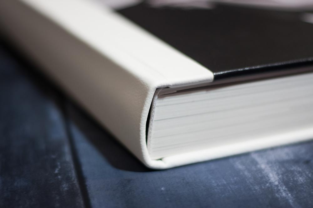 Queensberry white leather album closeup