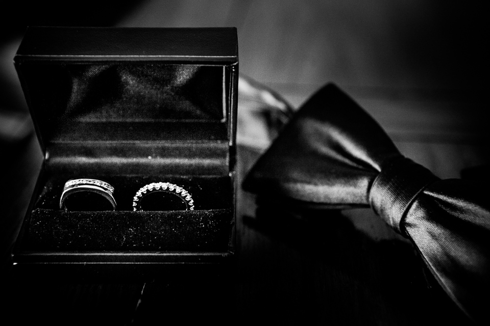 Black and white detail shot of wedding bands at Alpine Country Club in New Jersey.
