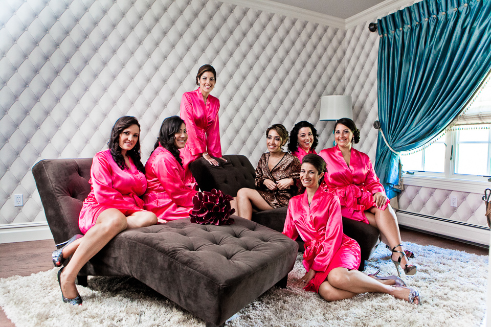 Bridesmaids in pink robes.